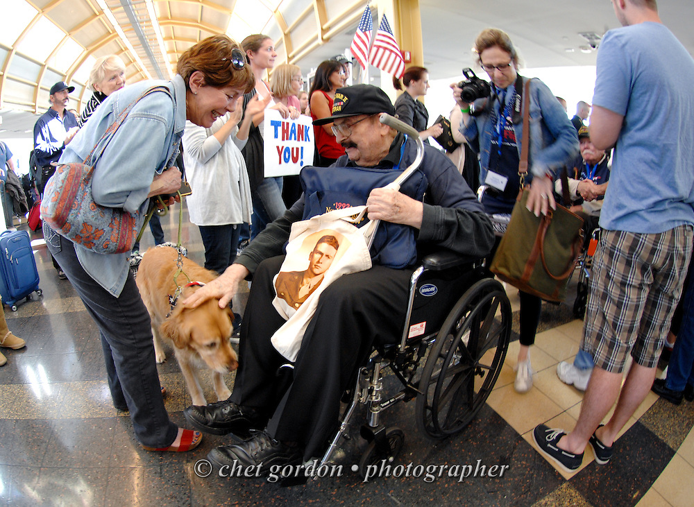 WWII Veterans and their escorts arrive at Reagan National Airport in Arlington, VA during their Hudson Valley Honor Flight to Washington, DC on Saturday, September 27, 2014. Nearly one hundred WWII Veterans from the Hudson Valley region of New York toured the WWII Memorial in Washington, DC and Arlington National Cemetery in Arlington, VA.  © www.chetgordon.com