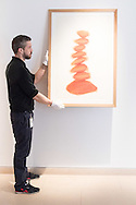A gallery technician hangs David Nash's &quot;Column&quot;, pastel on paper, created especially for the auction at the preview for the It&rsquo;s Our World charity auction at Christie's, Mayfair, London.<br /> Picture by Paul Davey/Focus Images Ltd +447966 016296<br /> 04/03/2016