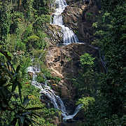 The Thor Thip waterfall in Kaeng Krachan National Park, Thailand. This 9 levels waterfall deep in the forest, water flows all year round. The waterfall is reached by a steep 4 kilometers jungle trail from the end of the Nam Tok Thorthip road, 35 km from the edge of the park and 55 km from the headquarters. The waterfall feds the Phetchaburi River.