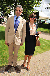 ROWAN ATKINSON and his wife SUNETRA at the 3rd day of the 2009 Glorious Goodwood racing festival held at Goodwood Racecourse, West Sussex on 30th July 2009.