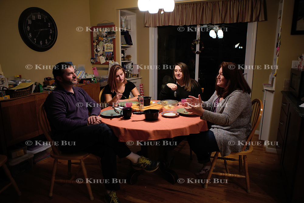 Assignment ID: 30215274A<br /> Slug: MONEY <br /> <br /> Jen Mouer, husband Daniel Mouer, and twin daughters Julia (brunette) and Nora (blond), both 16 and juniors at Atlee High School, have dinner Thursday, January 11, 2018, in Mechanicsville, VA.  She and her husband have been saving for years for their now 16 year-old twin daughters, but they don't have enough saved to pay the bills and had hoped to use a home equity loan to smooth out cash flow and the big lump sum payments they may owe. Now, they are reassessing. <br /> <br /> Photo by Khue Bui