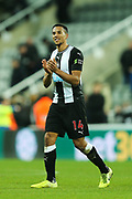Isaac Hayden (#14) of Newcastle United applauds the Newcastle supporters following the Premier League match between Newcastle United and Chelsea at St. James's Park, Newcastle, England on 18 January 2020.