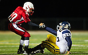 Neshannock's Ernie Burkes shows his sportsmanship as he helps Shenango's George Threats (33) up from the field in the fourth quarter yesterday at Neshannock High School.  Neshannock won the game 16-7.