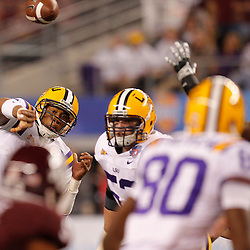 Jan 7, 2011; Arlington, TX, USA; DUPLICATE***LSU Tigers defensive tackle Ego Ferguson (9)***LSU Tigers quarterback Jordan Jefferson (9) throws to wide receiver Terrence Toliver (80) during the second quarter of the 2011 Cotton Bowl against the Texas A&M Aggies at Cowboys Stadium.  Mandatory Credit: Derick E. Hingle