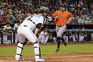 PHOENIX, AZ - AUGUST 15:  Jake Marisnick #6 of the Houston Astros runs home to score in front of Chris Iannetta #8 of the Arizona Diamondbacks in the second inning at Chase Field on August 15, 2017 in Phoenix, Arizona.  (Photo by Jennifer Stewart/Getty Images)