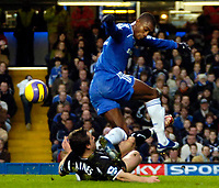 Photo: Ed Godden/Sportsbeat Images.<br />Chelsea v Wigan Athletic. The Barclays Premiership. 13/01/2007. Wigan's Leighton Baines stops Salomon Kalou (R) from advancing in the Wigan area.