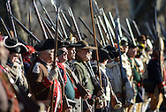 WASHINGTON CROSSING, PA - DECEMBER 7:  Re-enactors await instructions during a dress rehearsal for the crossing of the Delaware River at Washington Crossing State Park December 7, 2014 in Washington Crossing, Pennsylvania.  The dress rehearsal is held annually, about two weeks before the Christmas Day reenactment. (Photo by William Thomas Cain/Cain Images)