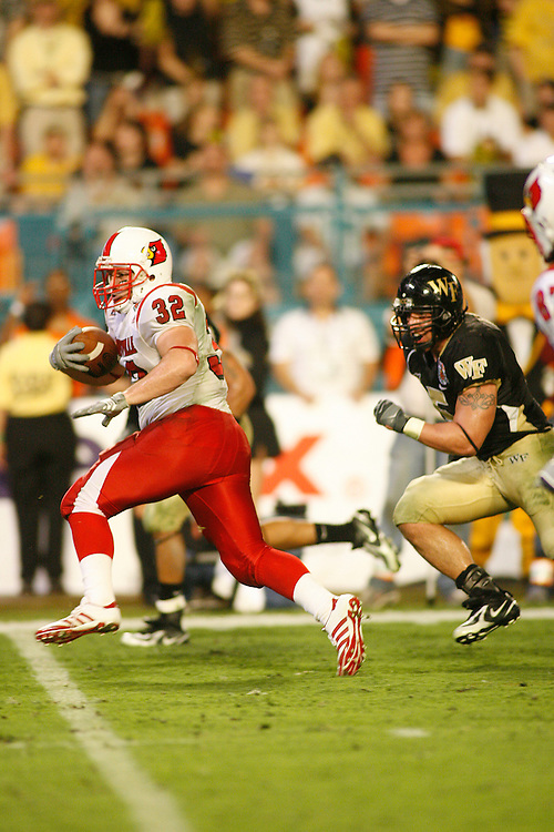 University of Louisville running back Brock Bolen runs past Wake Forest University rlinebacker Jon Abbate for a touchdown during the Louisville Cardinals 24-13 victory over the Wake Forest Demon Deacons at the 2007 Orange Bowl Game on January 2, 2007 at the Dolphin Stadium in Miami, Florida.