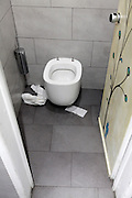public toilet with paper around the pot