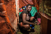 A 17 years old prostitute wash herself in her small hovel. In side areas girls pay about 100 birr (4 €) to rent the chippest place, to be used for sex work.<br />