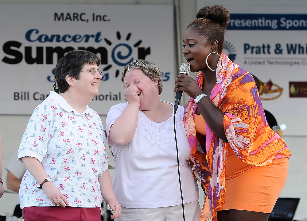 Nekita Waller recruits backup singers to the stage during a concert at MARC, Inc. of Manchester, a not-for-profit agency which supports people with disabilities in Manchester, Connecticut and surrounding towns.