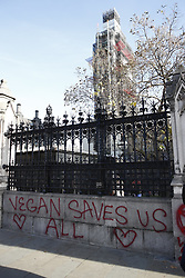 © Licensed to London News Pictures. 14/11/2018. London, UK. Protestors spray paint vegan slogans at Carriage Gate outside Parliament before being arrested. Prime Minister Theresa May will hold a cabinet meeting this afternoon to discuss a possible Brexit agreement. London, UK. Photo credit: Peter Macdiarmid/LNP