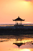 Man in pagoda at sunrise at the Bale retreat in Bali, Indonesia.