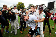 Surrey are County Champions - Rory Burns of Surrey is sprayed with beer as he is interviewed by TV during the final day of the Specsavers County Champ Div 1 match between Worcestershire County Cricket Club and Surrey County Cricket Club at New Road, Worcester, United Kingdom on 13 September 2018.