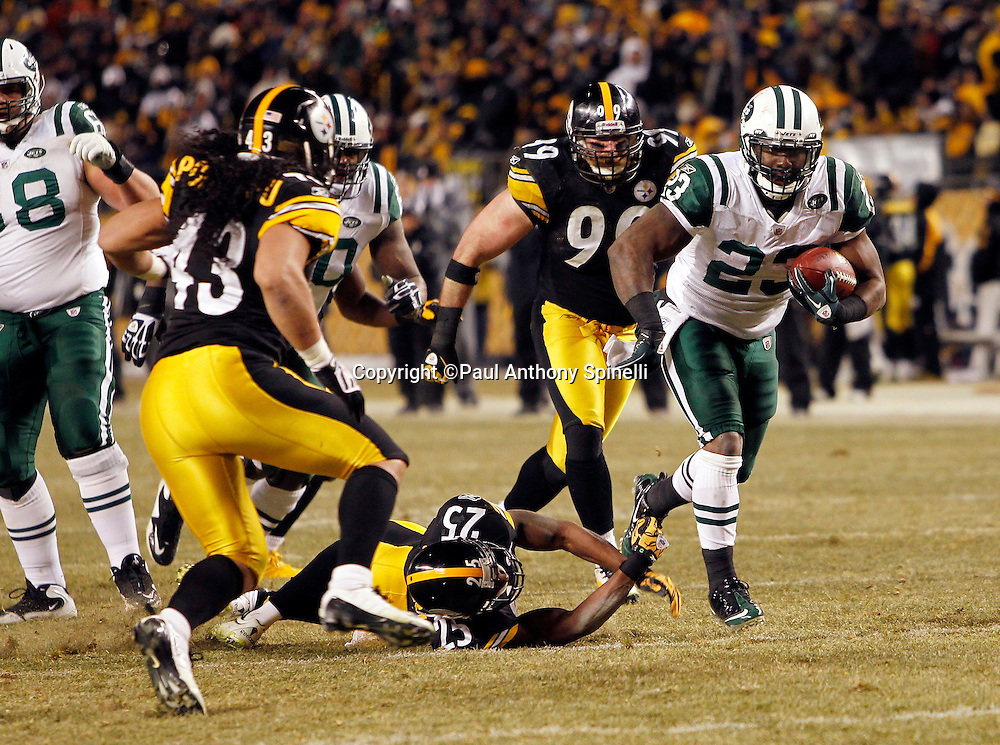 New York Jets running back Shonn Greene (23) runs the ball in the fourth quarter during the NFL 2011 AFC Championship playoff football game against the Pittsburgh Steelers on Sunday, January 23, 2011 in Pittsburgh, Pennsylvania. The Steelers won the game 24-19. (©Paul Anthony Spinelli)