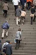 people walking up large stairs