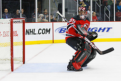 Dec 10, 2008; Newark, NJ, USA; New Jersey Devils goalie Scott Clemmensen (35) watches the puck go over the net after a save during the third period at the Prudential Center. The Devils defeated the Penguins 4-1.