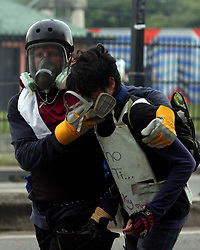 July 27, 2017 - Valencia, Carabobo, Venezuela - Protesters clash with police on the second day of the strike and general strike convened by the democratic unity force. (Credit Image: © Juan Carlos Hernandez via ZUMA Wire)
