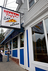 "Mystic Pizza, the restaurant that shares it's name with a popular film, with sign out front that reads ""Mystic Pizza  A Slice of Heaven., est. 1973"", Mystic, Connecticut."