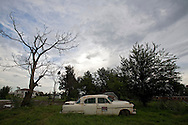 An old rusty car sits in a empty field next to the newly built Industrial Canal Levee in New Orleans Lower 9th Ward. .Much of the Lower 9th is empty of it's residents since the Katrina disaster.