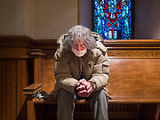 "15 MARCH 2020 - DES MOINES, IOWA: A man wearing a surgical mask prays by himself in the vestibule of a Catholic church in Des Moines. The Des Moines diocese announced that Catholics in Des Moines were ""relieved of the Sunday Mass obligation"" because of fears over the Coronavirus. Most churches in the Des Moines area canceled their Sunday services or switched to an online service this week. Those churches that conducted Sunday services imposed ""social distancing"" guidelines, including no physical contact, and had significantly lower attendance. The Governor of Iowa announced Saturday night that the Coronavirus in Iowa had entered the ""community spread"" phase when a person in Dallas County, in the Des Moines metropolitan area, tested positive for Coronavirus. This is the first reported case in the Des Moines area. As of Sunday morning, Iowa was reporting 18 people tested positive for Coronavirus.            PHOTO BY JACK KURTZ"