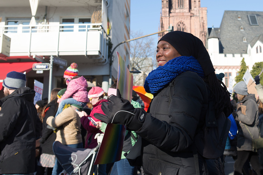 "The Women's March Frankfurt on January 21, 2017 was attended by over 2,100 people.  Photographer Jenny Mayfield captured the organizers, volunteers and participants as they marched from the Alter Oper to the Römer.  The collective chant was ""Gemeinsam Stark."""