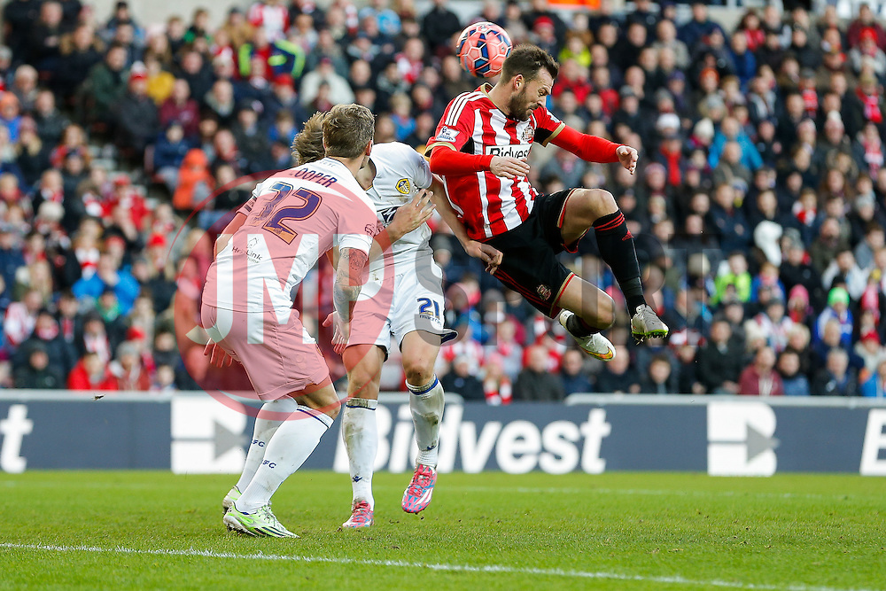 Steven Fletcher of Sunderland tries to get a head to a cross as Charlie Taylor of Leeds United competes - Photo mandatory by-line: Rogan Thomson/JMP - 07966 386802 - 04/01/2015 - SPORT - FOOTBALL - Sunderland, England - Stadium of Light - Sunderland v Leeds United - FA Cup Third Round Proper.