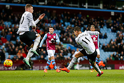 Kevin Mirallas of Everton shoots as Ross Barkley jumps clear - Mandatory byline: Rogan Thomson/JMP - 01/03/2016 - FOOTBALL - Villa Park Stadium - Birmingham, England - Aston Villa v Everton - Barclays Premier League.