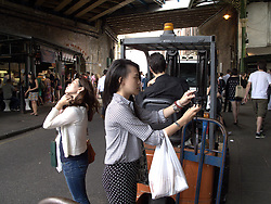 UK ENGLAND LONDON 27JUL13 - A tourist takes a photo at Borough Market, Southwark, London.<br /> <br /> It is one of the largest and oldest food markets in London, and sells a large variety of foods from all over the world.<br /> <br /> <br /> <br /> jre/Photo by Jiri Rezac<br /> <br /> <br /> <br /> &copy; Jiri Rezac 2013