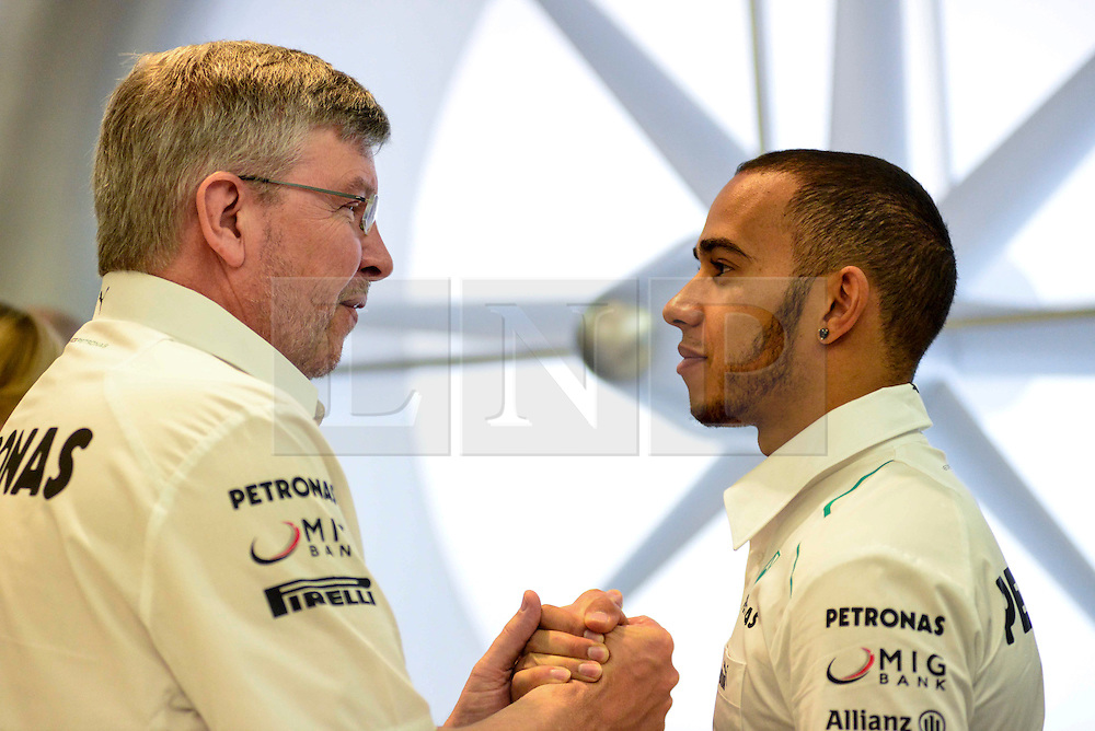 © London News Pictures. 25/06/2013. London, UK. Mercedes F1 boss Ross Brawn (left) and river Lewis Hamilton speaking at a IWC watches promotion at Selfridges store in London. Photo credit : Abdel Abdulai/LNP