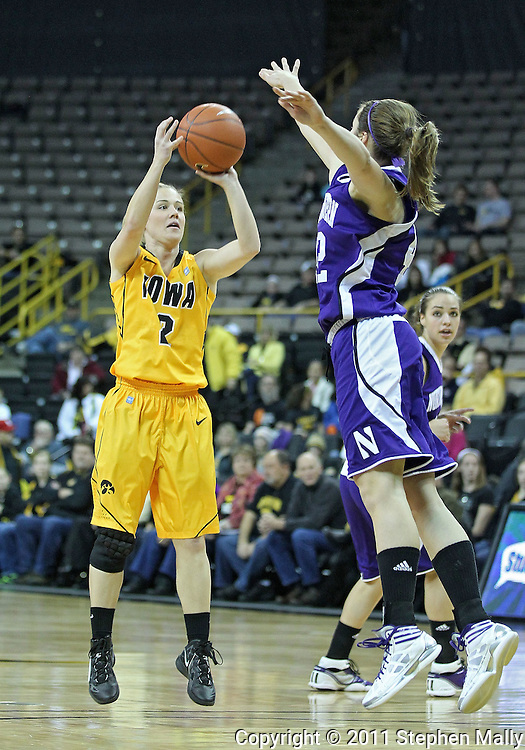 December 30, 2011: Iowa Hawkeyes guard Kamille Wahlin (2) puts up a shot as Northwestern Wildcats guard Karly Roser (42) defends during the NCAA women's basketball game between the Northwestern Wildcats and the Iowa Hawkeyes at Carver-Hawkeye Arena in Iowa City, Iowa on Wednesday, December 30, 2011.