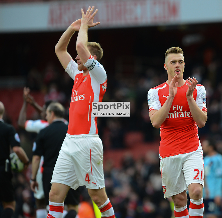 Per Mertesacker of Arsenal and Calum Chambers of Arsenal celebrate victory  during Arsenal v West Ham, Barclays Premier League, 14 March 2015 at Emirates Stadium, London, England (c) Salvio Calabrese | SportPixPix.org.uk