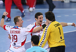 Team of Poland (Tomasz Tluczynski (19) of Poland, Bartlomiej Jaszka (2) of Poland and Goalkeeper of Poland Slawomir Szmal)) celebrates after winning the 21st Men's World Handball Championship 2009 Bronze medal match between National teams of Poland and Denmark, on February 1, 2009, in Arena Zagreb, Zagreb, Croatia.  Won of Poland 31:23. (Photo by Vid Ponikvar / Sportida)