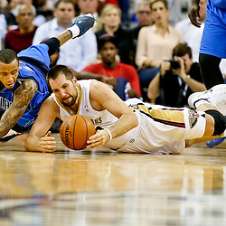 Dec 4, 2013; New Orleans, LA, USA; New Orleans Pelicans power forward Ryan Anderson (33) and Dallas Mavericks shooting guard Monta Ellis (11) dive for a loose ball during the second half of a game at New Orleans Arena.The Mavericks defeated the Pelicans 100-97. Mandatory Credit: Derick E. Hingle-USA TODAY Sports