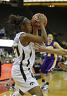 December 22 2010: Iowa guard Kachine Alexander (21) hangs onto the ball during the first half of an NCAA college basketball game at Carver-Hawkeye Arena in Iowa City, Iowa on December 22, 2010. Iowa defeated Northern Iowa 75-64.