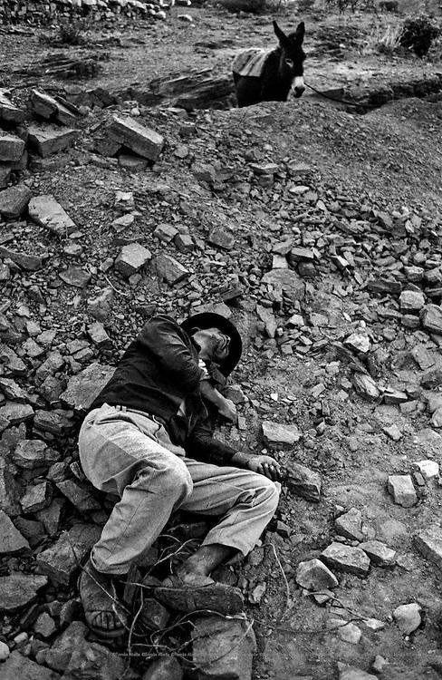 "Lying down by the ""chicha"". Cochabamba, Bolivia."