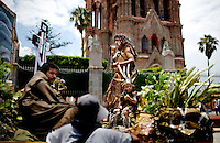 The community of Valle de Maiz, the oldest neighborhood of San Miguel de Allende, celebrates the Holy Cross, a three-day festival that features a parade of of indigenous and Aztec dancing, and mojigangas, giant puppets, in San Miguel de Allende, Mx., on Sunday, May 31, 2009.