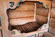 Old style bed and blanket. Visit the farm museum of Rygnestadtunet (at Nordigard, in Nørdre Rygnestad, near Valle, Setesdal, Aust-Agder, Norway) to admire a unique 1590 three-story storehouse, a farmhouse with open-hearth room dating from before the Black Death (1349-50), and 15th century painted textiles.