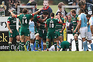 Tigers players celebrate another try during the Aviva Premiership match at Welford Road, Leicester<br /> Picture by Andy Kearns/Focus Images Ltd 0781 864 4264<br /> 06/09/2014