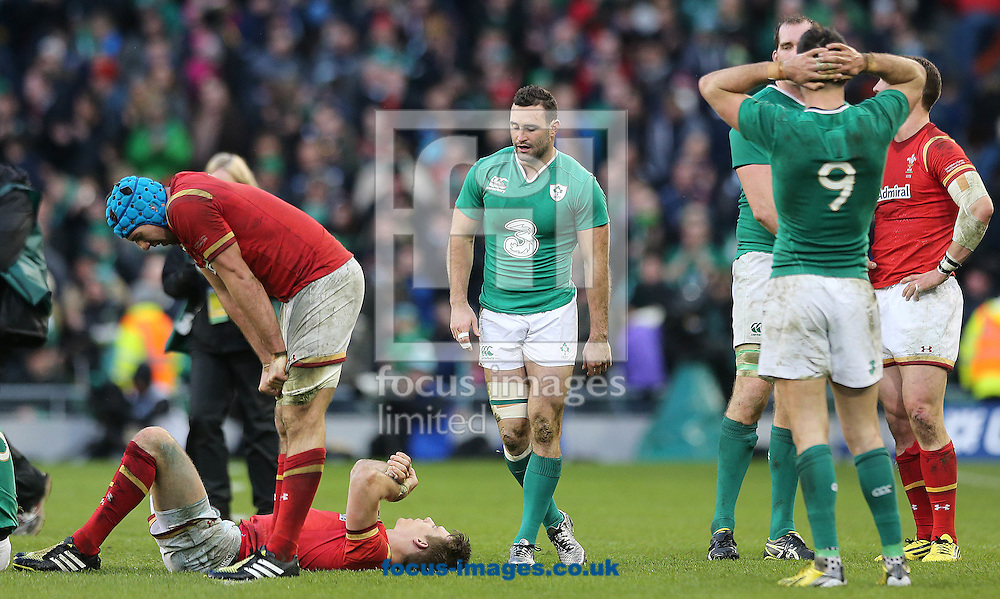 Players from both teams show their disappointment after the full time whistle, the RBS 6 Nations match at the Aviva Stadium, Dublin<br /> Picture by Lorraine O'Sullivan/Focus Images Ltd +353 872341584<br /> 07/02/2016