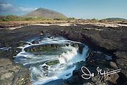 Water cascades in a tidal pool on Santiago island, Galapagos islands, Ecuador.