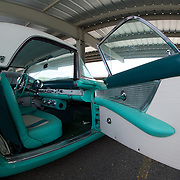 C'mob, hop on in the best looking T-Bird Ford ever made...a '55 in that classic '50s aquamarine.