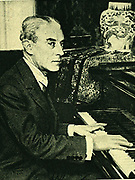 (Joseph) Maurice Ravel (1875-1937) French composer, at the piano. After a photograph.