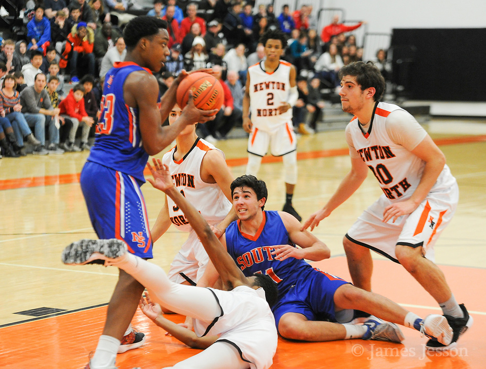 Newton South players scramble to get control of the ball during the game against Newton North at Newton North, Dec. 27, 2018.   [Wicked Local Photo/James Jesson]