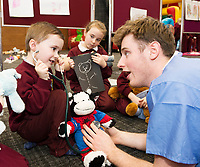 18/01/2018 Josh O'Neil  and Ava Walsh and their Teddys from Corandulla National School at the Teddy Bear Hospital at NUI Galway with 3rd year Medical Student David O'Sullivan from Galway. Students get used to dealing with Kids and Kids get a Hospital experience with a difference. Photo:Andrew Downes, XPOSURE