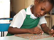 Haitham Maulid is one of the many children at Saateni nursery school benefitting from the improved teaching methods and resources. VSO volunteer, Daphne Sharpe is working as a teacher trainer. Daphne has now trained over 100 nusery school teachers and 18 heads of pre school.
