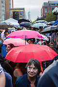 "New York, NY – 16 September 2019. Massachusetts Senator and Democratic Presidential candidate Elizabeth Warren drew a large and enthusiastic crowd at a speech for her increasingly popular 2020 presidential campaign in New York's Washington Square. A light rain fell prior to her speech, and as umbrellas popped open, soneone said ""we have a plan for that,"" echoing Warren's frequently used phrase."