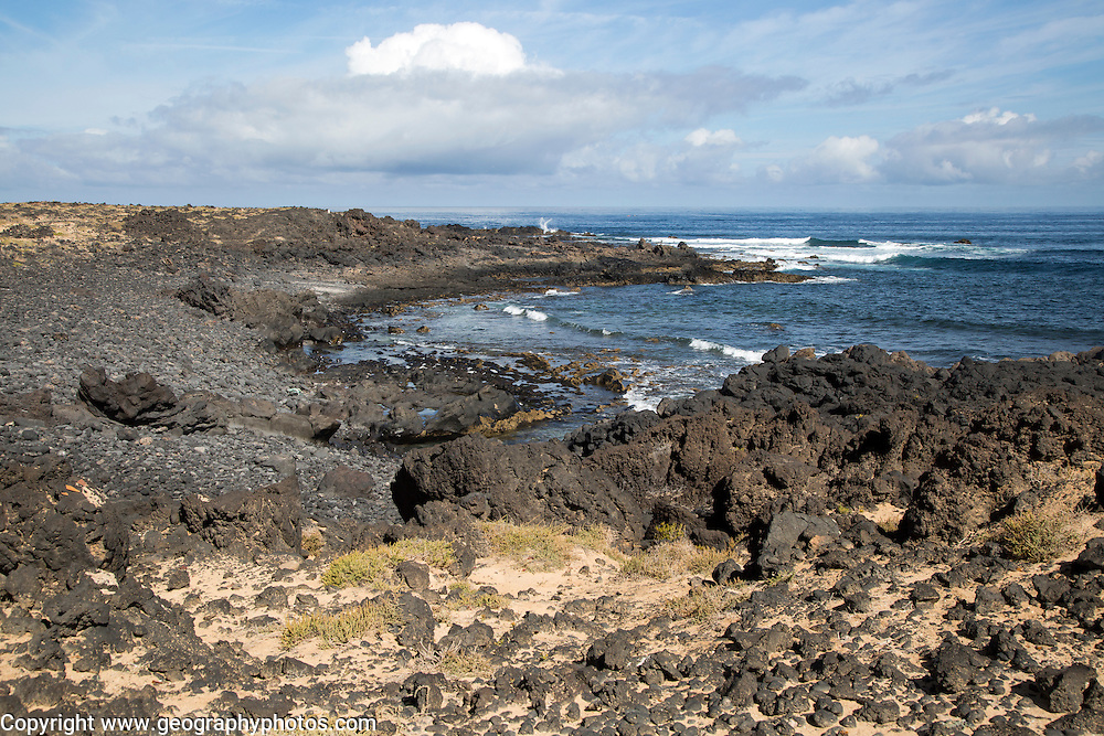Small rocky cove at Caleta de Caballo, Lanzarote, Canary islands, Spain