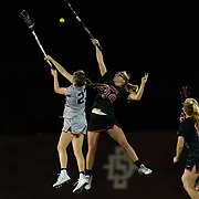 23 March 2018: San Diego State Aztecs midfielder Bailey Brown fights a Liberty defender for a loose ball in the first half. The Aztecs beat the Lady Flames 11-10 Friday night. <br /> More game action at sdsuaztecphotos.com