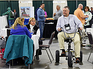 Brendan Egan, Burlington recreation director, takes a giant tricycle for a spin from Perfect Parties USA at the Massachusetts Recreation and Park Association Conference and Trade Show at the DCU Center on Tuesday, March 14, 2017.